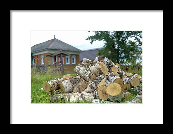 Nature Framed Print featuring the photograph Firewood In The Village by Larisa Grib