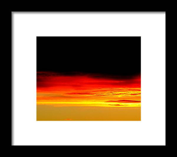 Sunset. Framed Print featuring the photograph Fire in the Sky. by Joyce Woodhouse