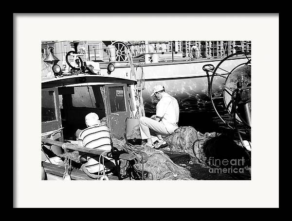 Fisherman Framed Print featuring the photograph Fisherman by John Rizzuto