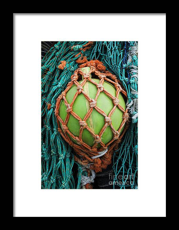 Fishing Nets Framed Print featuring the photograph Fishing Nets by Elena Nosyreva