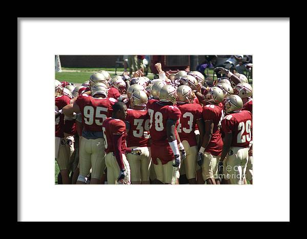 Football Huddle Framed Print featuring the photograph Fist Pump by Allen Simmons