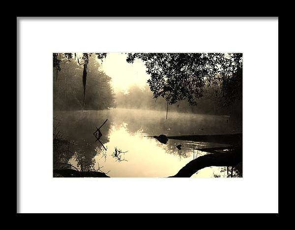 Fog And Light In Sepia Framed Print featuring the photograph Fog And Light In Sepia by Warren Thompson