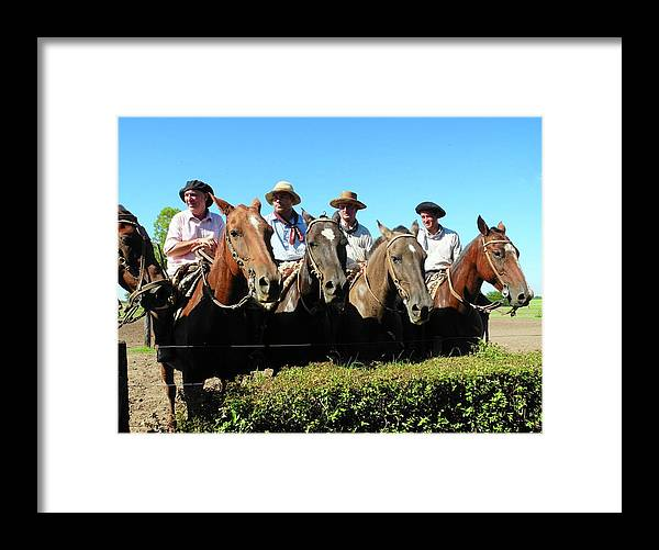 Four Gauchos Framed Print featuring the photograph Four Gauchos in Argentina by Kirsten Giving