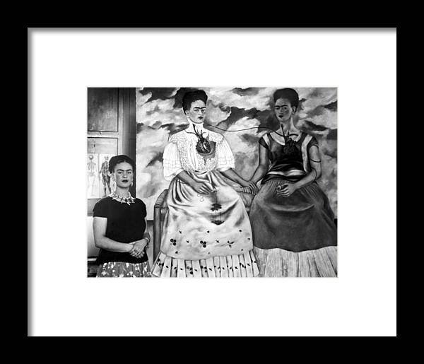 Frida Kahlo Shown With Her Painting Me Framed Print by Everett