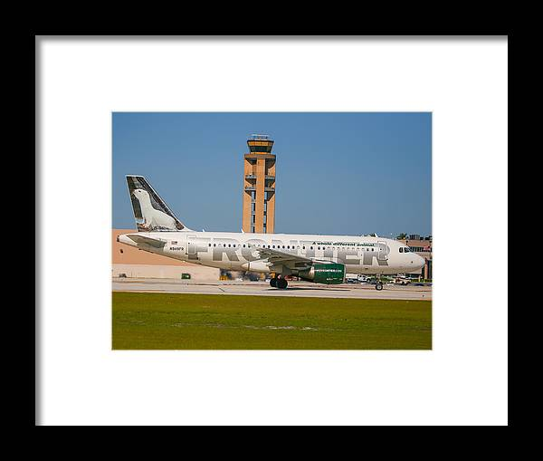 Frontier Airline Framed Print featuring the photograph Frontier Airline by Dart and Suze Humeston