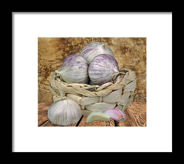 Garlik Framed Print featuring the photograph Garlic In The Basket by Manfred Lutzius
