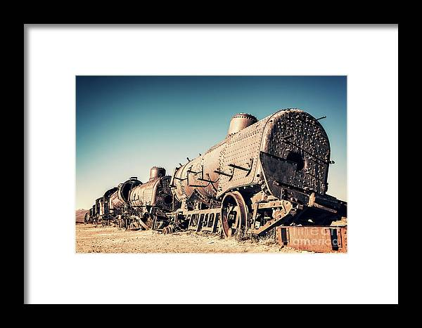 Train Framed Print featuring the photograph Ghost Train In Uyuni, Bolivia by Delphimages Photo Creations