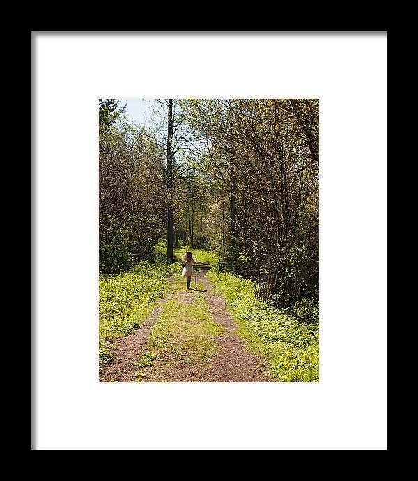 Girl On Trail Framed Print featuring the photograph Girl On Trail With Walking Stick by Nancy Clendaniel
