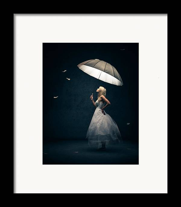 Girl Framed Print featuring the photograph Girl With Umbrella And Falling Feathers by Johan Swanepoel