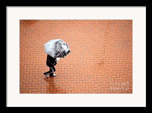 East Framed Print featuring the photograph Going East- Umbrellas Series 1 by Carlos Alvim