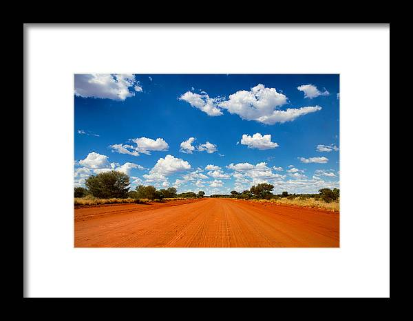 Red Framed Print featuring the photograph Going Home by Chris Tangey