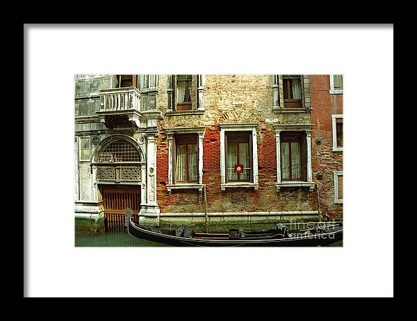 Venice Framed Print featuring the photograph Gondola In Front Of House In Venice by Michael Henderson