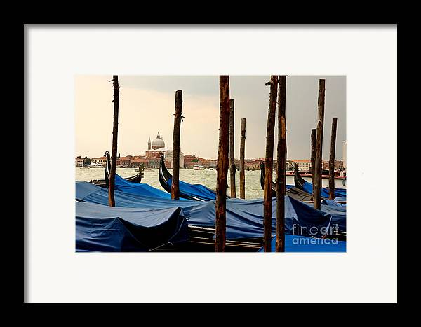 Venice Framed Print featuring the photograph Gondolas And Poles In Venice by Michael Henderson