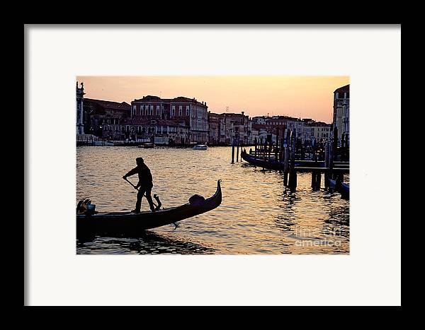 Venice Framed Print featuring the photograph Gondolier In Venice In Silhouette by Michael Henderson