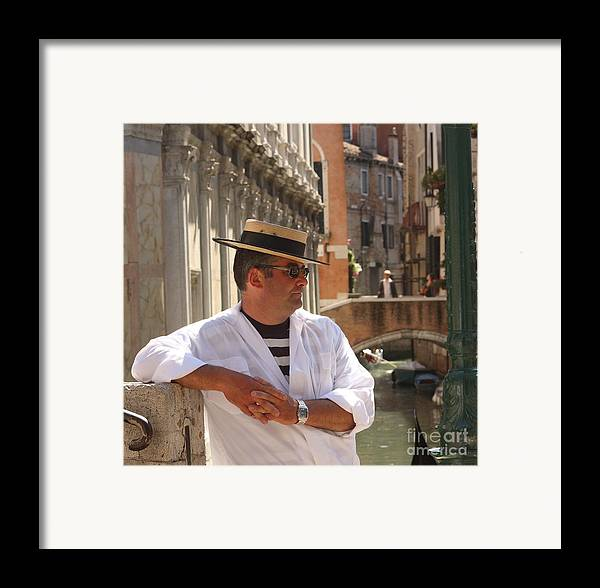 Gondolier Framed Print featuring the photograph Gondolier In Venice Waiting For A Fare by Michael Henderson