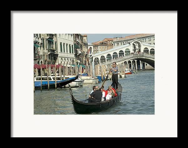 Venice Framed Print featuring the photograph Gonfolas On Venice Canal At Rialto Bridge by Charles Ridgway