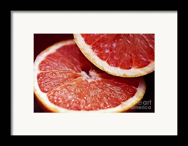 Circle Framed Print featuring the photograph Grapefruit Halves by Ray Laskowitz - Printscapes