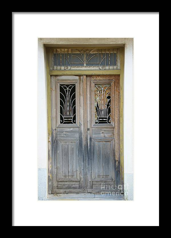 Greece Framed Print featuring the photograph Greek Door With Wrought Iron Window by Maria Varnalis