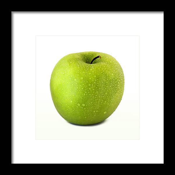 Apple Granny Smith Photographs Framed Print featuring the photograph Green Apple by D Plinth