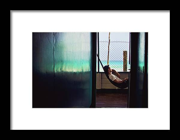 Afternoon Framed Print featuring the photograph Guy With The Hat Lying In A Hammock On The Porch Of The Old House And Relaxing By The Caribbean Sea by Srdjan Kirtic