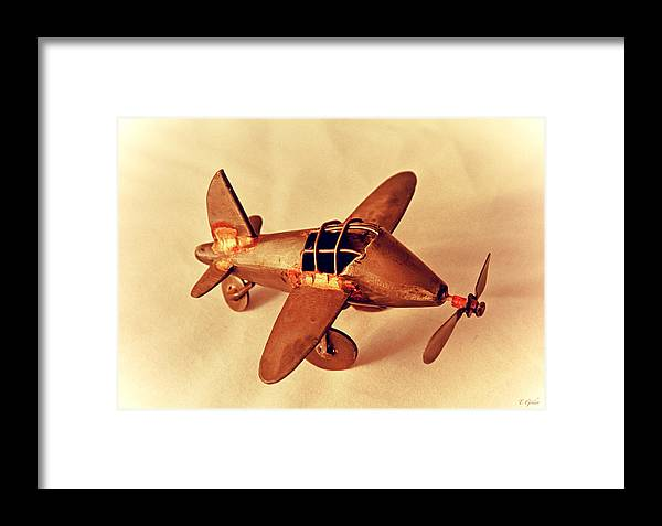 Metal Plane Framed Print featuring the photograph Handmade Metal Toy Plane by Tony Grider