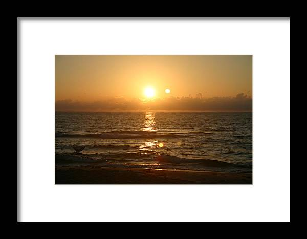 Sunrise Framed Print featuring the photograph Here Comes The Sun. by Dennis Curry