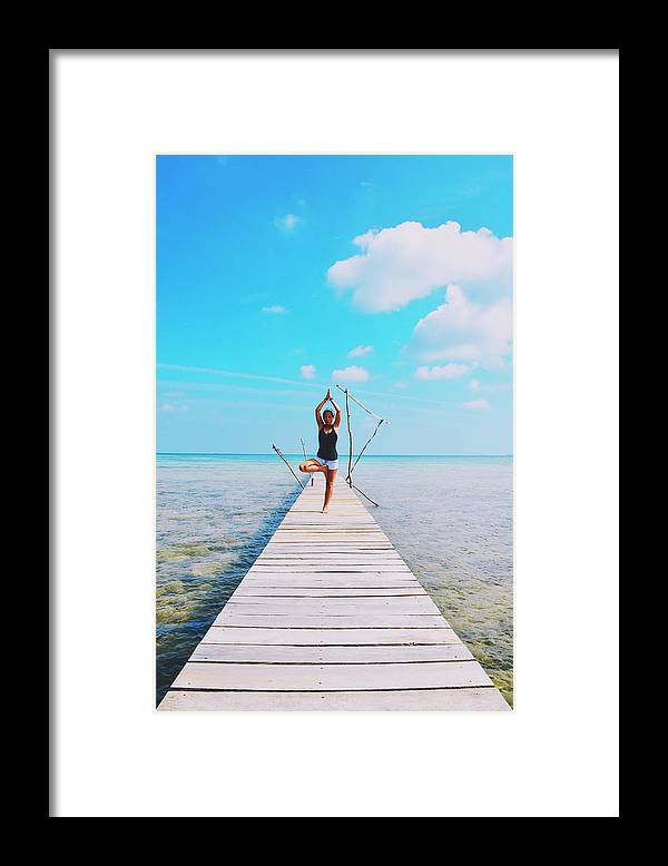 Above The Water Framed Print featuring the photograph Hot Girl In White Jeans Doing Yoga On The Wooden Pier By The Sea by Srdjan Kirtic