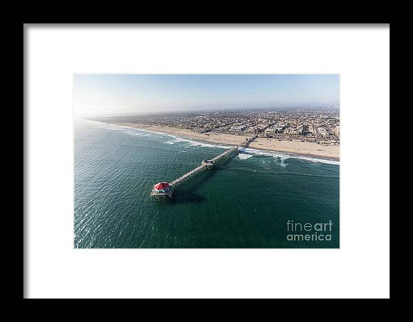 Huntington Beach Framed Print featuring the photograph Huntington Beach Pier Aerial In Southern California by Trekkerimages Photography