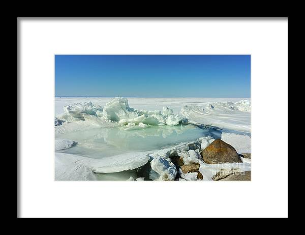 Ice Framed Print featuring the photograph Icy Sculptures On Lake Simcoe by Les Palenik
