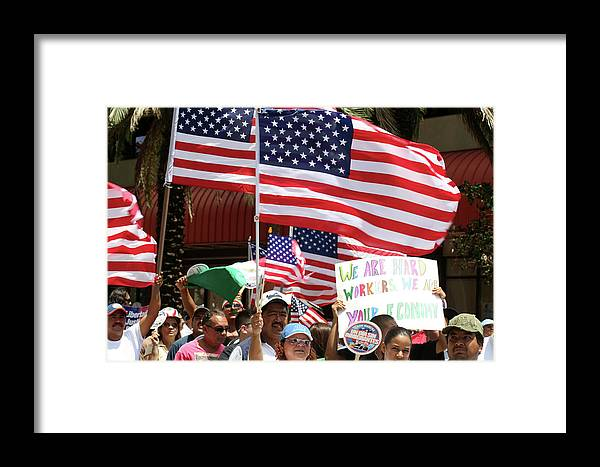 Workers Framed Print featuring the photograph Immigrant Marcher In Orlando by Carl Purcell