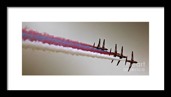Red Arrows Framed Print featuring the photograph In One Row by Angel Ciesniarska