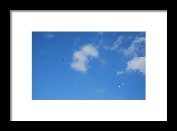 Bubbles Framed Print featuring the photograph In The Clouds by Marilynne Bull