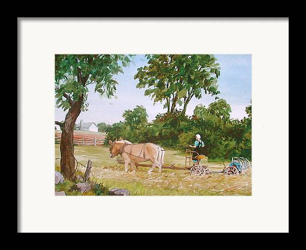 Amish Framed Print featuring the painting In The Hayfield by Faye Ziegler