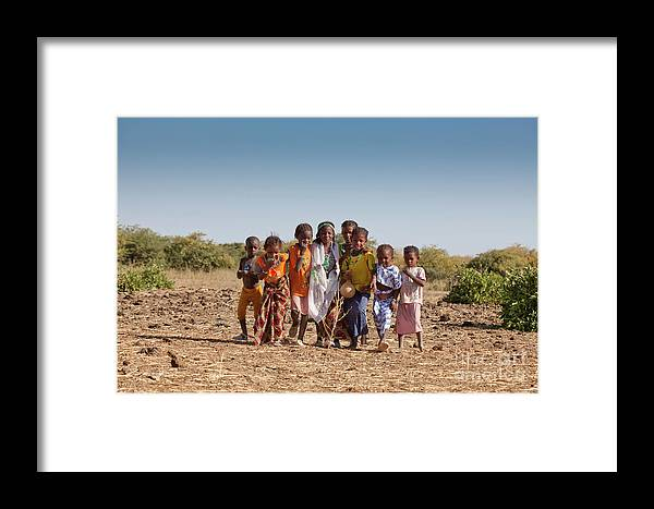 People Framed Print featuring the photograph In The Village Of Bantagiri Xii by Irene Abdou