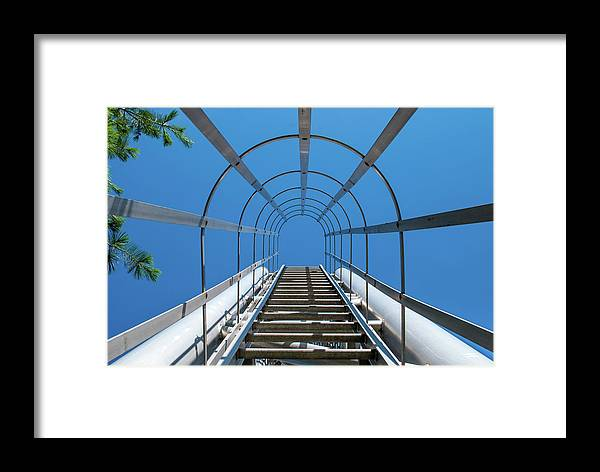 Abstract Framed Print featuring the photograph Industrial Ladder by Len Tauro