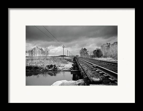 Railroad Tracks Framed Print featuring the photograph Into The Distance by Matthew Angelo