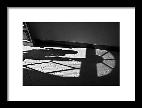Shadow Framed Print featuring the photograph It Leaves... Do Not Hold It... by Vadim Grabbe