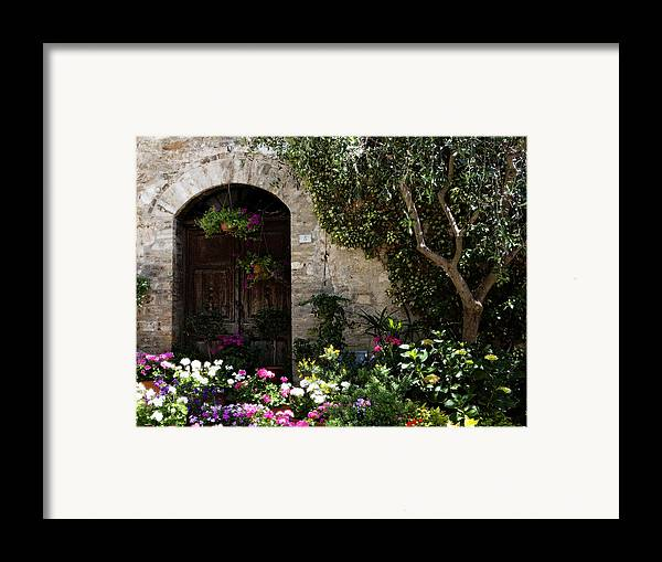 Flower Framed Print featuring the photograph Italian Front Door Adorned With Flowers by Marilyn Hunt