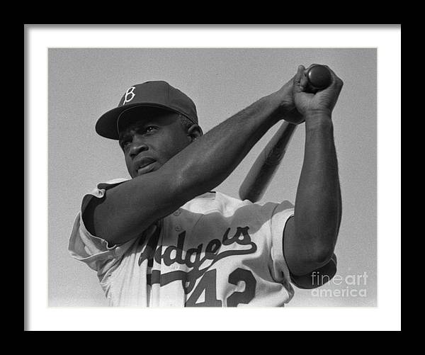 Jackie Robinson swinging a bat in Dodgers uniform by Celestial Images