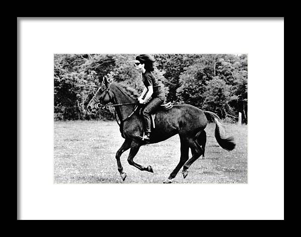 History Framed Print featuring the photograph Jacqueline Kennedy, Riding A Horse by Everett