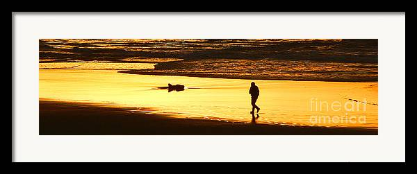 Pacific Ocean Framed Print featuring the photograph Jog At Sunset by Larry Keahey