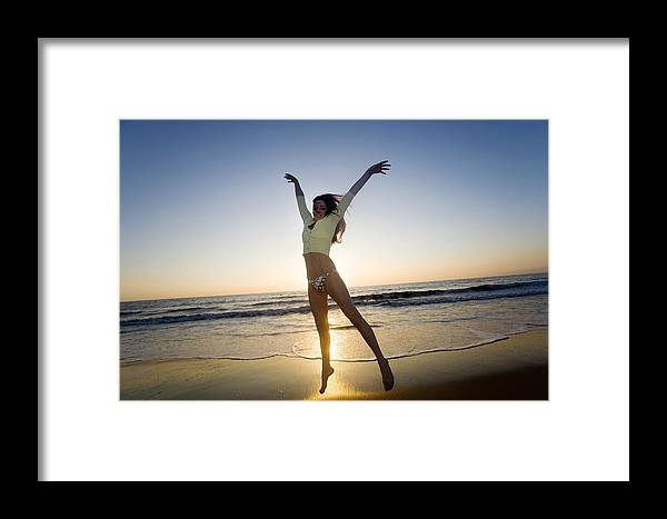 Ocean Framed Print featuring the photograph Jump - Beach by Brad Rickerby