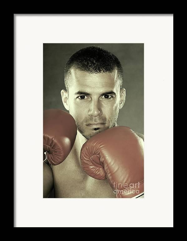 Kickboxer Framed Print featuring the photograph Kickboxer by Oleksiy Maksymenko