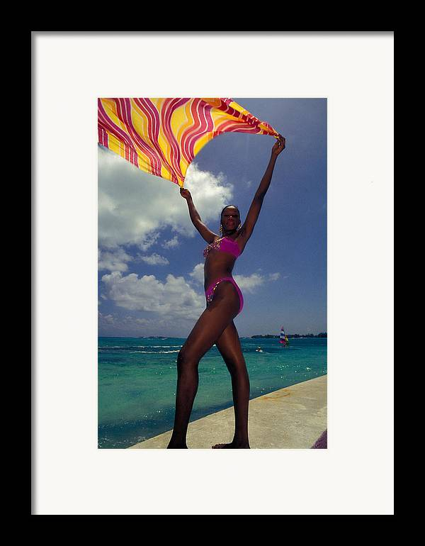 Black Framed Print featuring the photograph Lady In The Wind by Carl Purcell