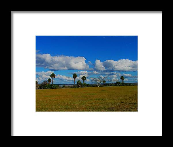 Clouds Framed Print featuring the photograph Lake View With Clouds by Judy Waller