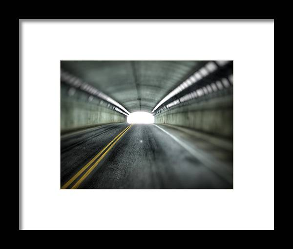 Framed Print featuring the photograph Light At The End Of The Tunnel by Christopher McClune-Case