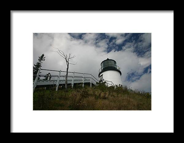 Lighthouse Framed Print featuring the photograph Light In The Sky by Dennis Curry