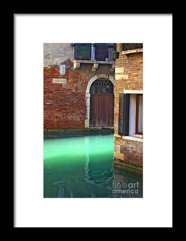 Venice Framed Print featuring the photograph Light On Canal In Venice by Michael Henderson