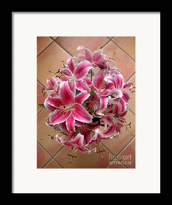 Nature Framed Print featuring the photograph Lilies Gathered On Tile by Lucyna A M Green