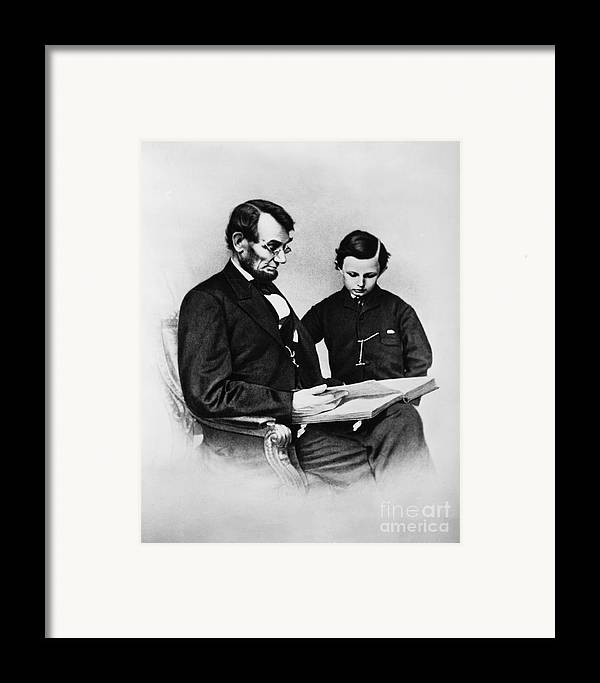 History Framed Print featuring the photograph Lincoln Reading To His Son by Photo Researchers